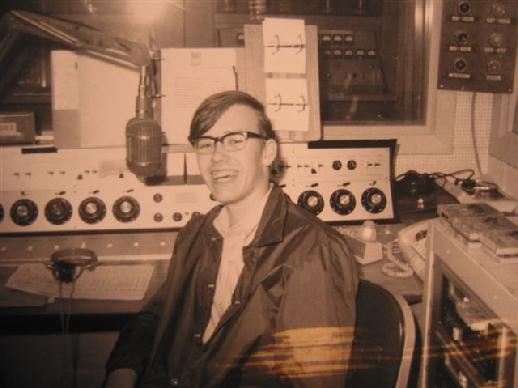 A 1969 shot of me (Rick Burnett a/k/a Rick Mason) when I was visiting the studio. Jimmy Reed let me sit in his chair, but did not let me go on the air. I did not get to talk to the Twin Cities until 1972 when I was hired as a part-time DJ at KTCR-FM, a country station in Minneapolis. I was still in high school when this photo was taken. If you look carefully, you can see the old WDGY transmitter through the studio glass.